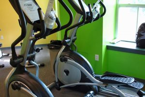 Two elliptical machines side by side